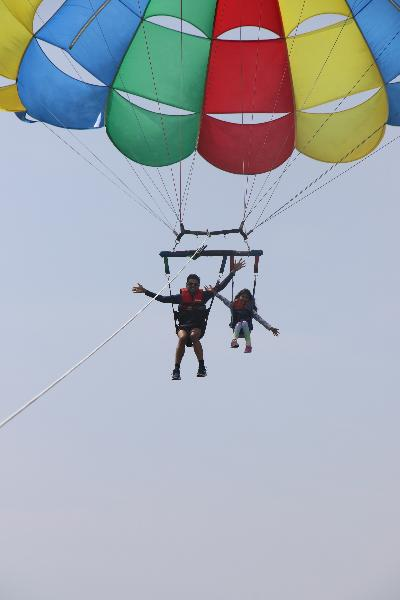 Me with my daughter having fun with parasailing